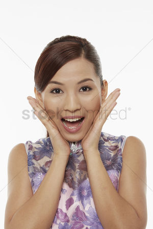 Lunar new year : Woman in traditional clothing with a surprised facial expression
