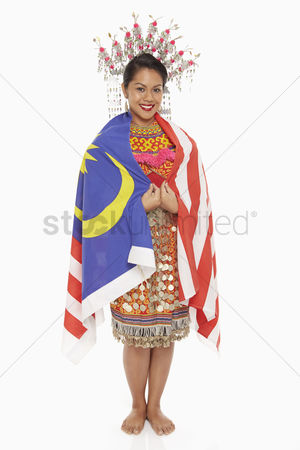 Bidayuh ethnicity : Woman in traditional clothing wrapped around with a malaysian flag