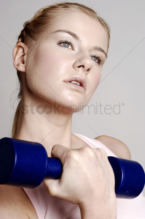 Strong : Woman lifting dumbbell