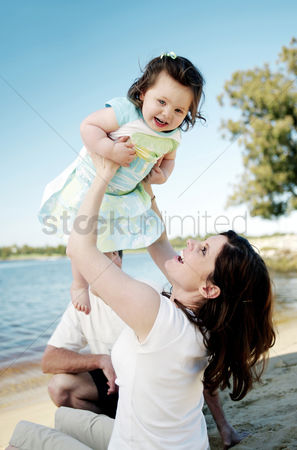Affectionate : Woman lifting up her daughter
