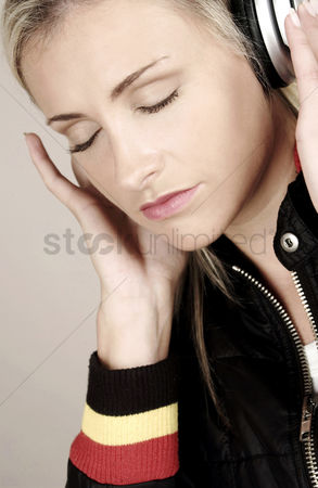 Jacket : Woman listening to music on the headphones