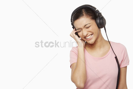 Malaysian indian : Woman listening to music through the headphone