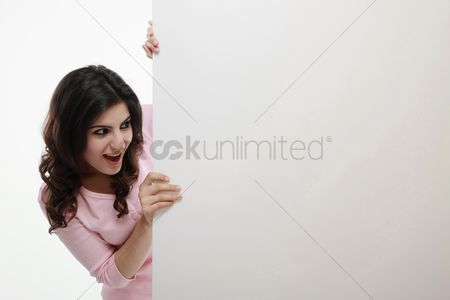 Creativity : Woman looking at board