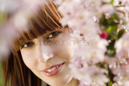 Blossom : Woman looking through blossoms