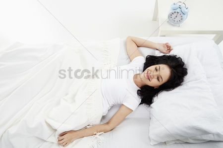 Malay : Woman lying on the bed  smiling
