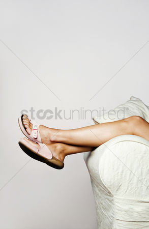 Resting : Woman lying on the couch with the focus on the legs