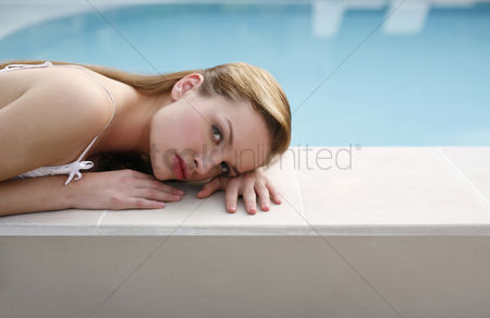 Composed : Woman lying on the pool side