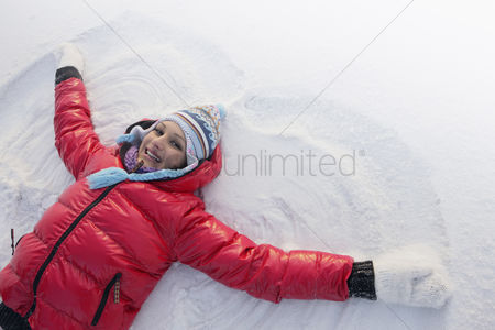 Creativity : Woman making snow angel
