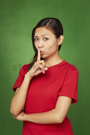 Malay : Woman placing finger on her lips