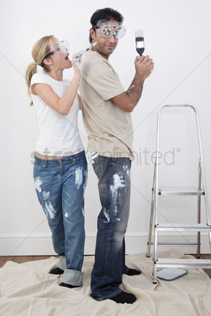 Paint brush : Woman playfully painting boyfriend s face