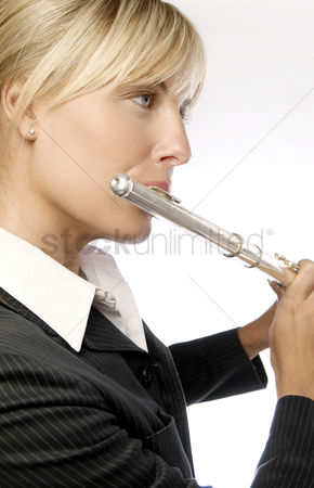 Blowing : Woman playing flute