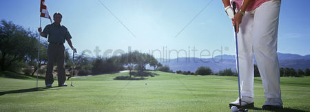 Land : Woman playing golf low section