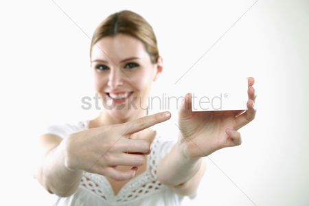 China : Woman pointing at business card