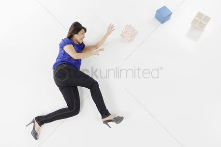 Excited : Woman posing on the floor with gift boxes