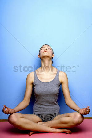 Enjoying : Woman practicing yoga