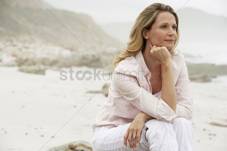 Relaxing : Woman relaxing on beach