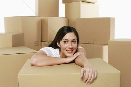 Interior background : Woman resting on cardboard box