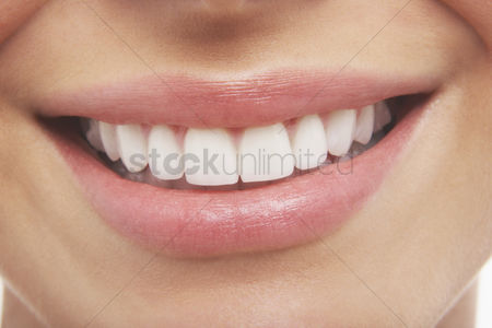 Young woman : Woman s open mouth perfect teeth