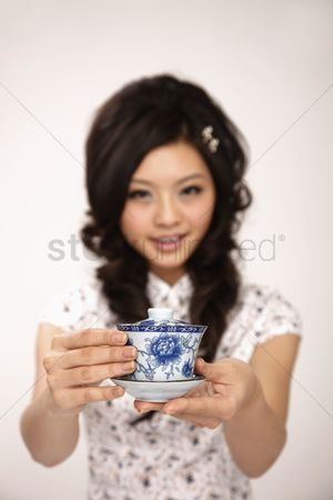 Respect : Woman serving a cup of chinese tea