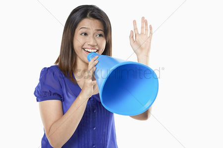 Excited : Woman shouting into a megaphone