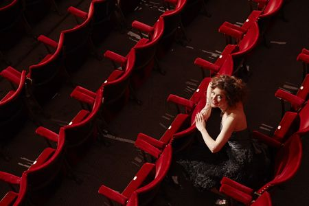 Arts : Woman sitting in theatre stalls high angle view