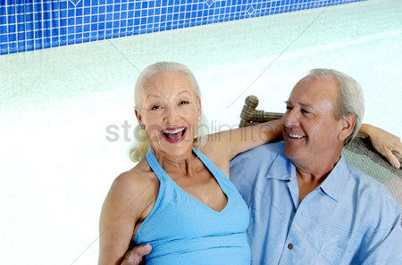 Relaxing : Woman sitting on her husband s lap