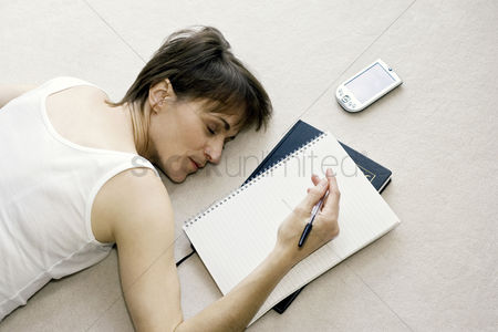 Enjoying : Woman sleeping on the floor while doing work