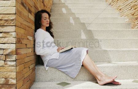 Stairs : Woman sleeping with a book her lap