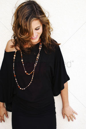 Fashion : Woman smiling while looking down