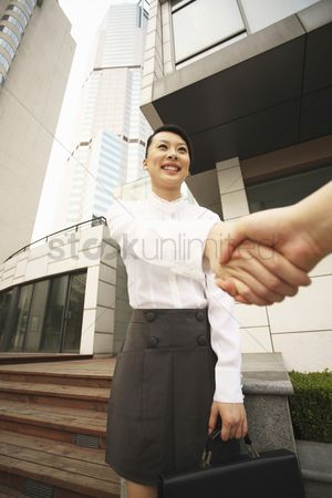 Stairs : Woman smiling while shaking hands