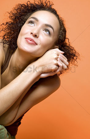 Fashion : Woman smiling while thinking