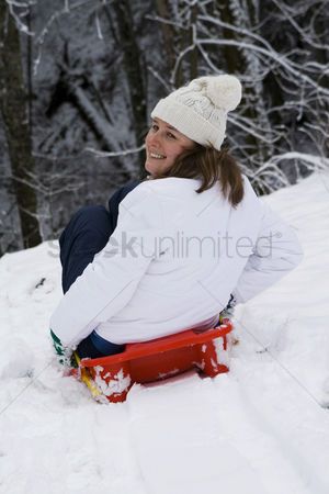 Coldness : Woman snow sliding