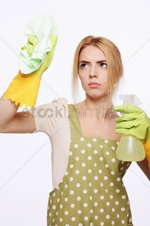 Housewife : Woman spraying and wiping