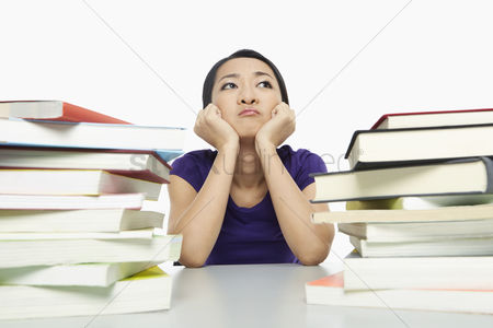 China : Woman surrounded by books  looking bored