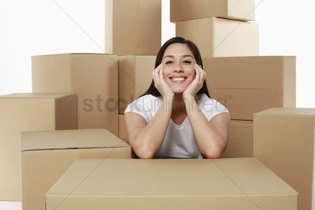 Interior background : Woman taking a break from unpacking