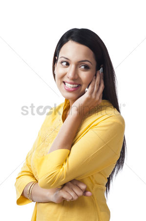 Housewife : Woman talking on a mobile phone and smiling