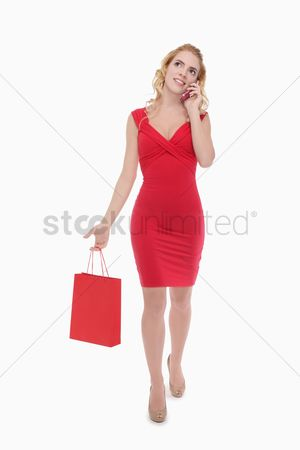 Shopping background : Woman talking on mobile phone while shopping