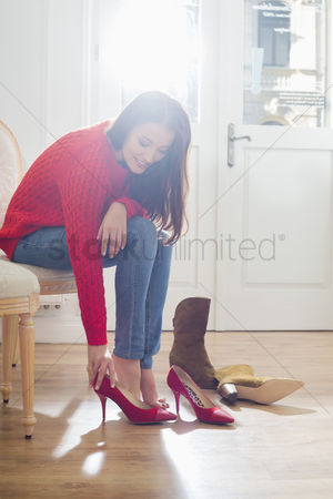 Fashion : Woman trying on footwear in store