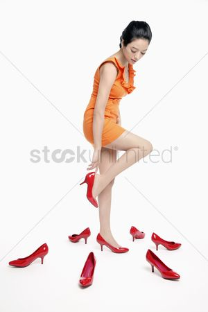 Shopping background : Woman trying on shoes