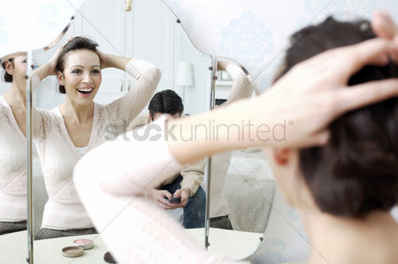 Husband : Woman tying up her hair