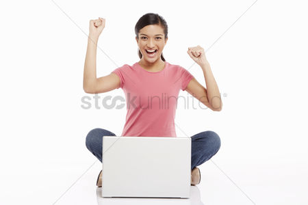 Three quarter length : Woman using laptop and cheering