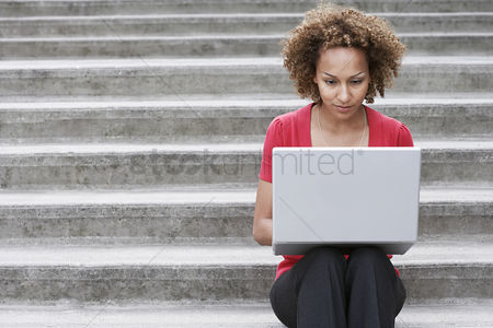 Steps : Woman using laptop on steps