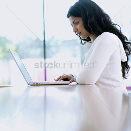 Mature : Woman using laptop