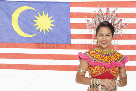 Bidayuh ethnicity : Woman with a malaysian flag at the background