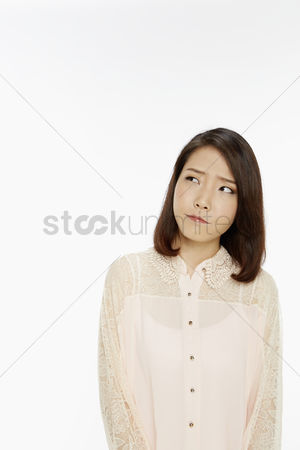 Frowning : Woman with an unsure look on her face