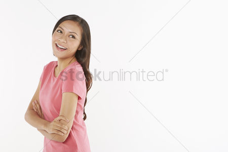 Malay : Woman with arms crossed  laughing