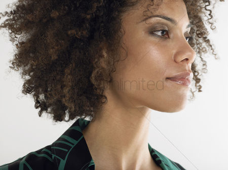 Head shot : Woman with curly hair head and shoulders in studio