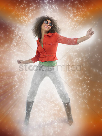 Dancing : Woman with curly hair wearing sunglasses dancing with lighting effect