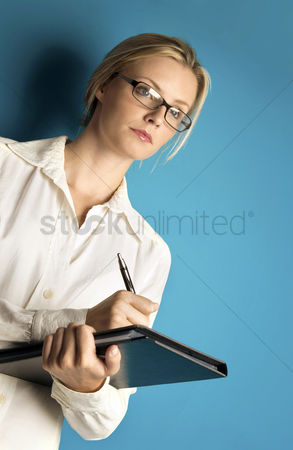 Thought : Woman with glasses writing