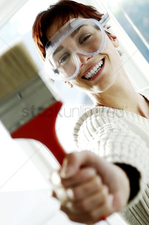 Paint brush : Woman with goggles holding a paintbrush